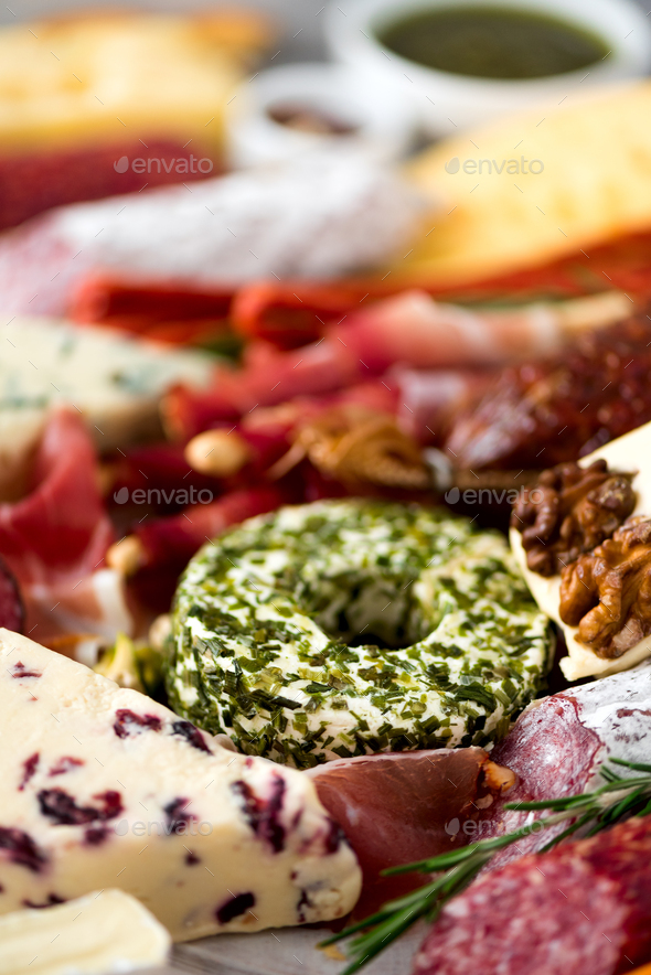 Cold smoked meat plate. Traditional italian antipasto, cutting board with salami, prosciutto, ham - Stock Photo - Images
