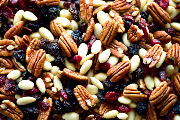 Mixed nuts and raisins in wooden bowl. Healthy food and snack. Walnut, pistachios, almonds - Stock Photo - Images
