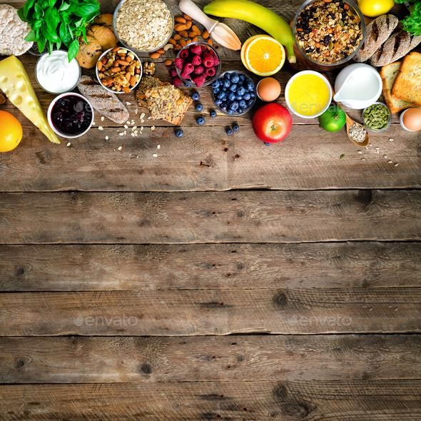 Healthy breakfast ingredients, food frame. Granola, egg, nuts, fruits, berries, toast, milk, yogurt - Stock Photo - Images