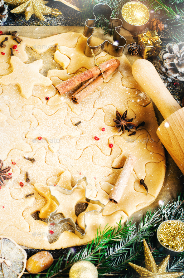 Ginger Bread Cookies. Christmas background with gifts, candle, cones, cinnamon sticks, dry orange - Stock Photo - Images