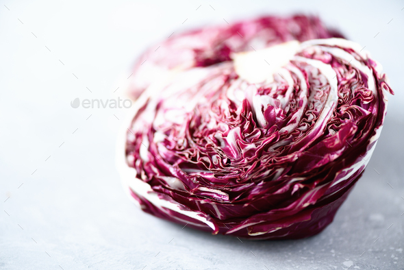 Radicchio, purple violet salad on grey concrete background. Copy space, close up. Raw, vegan - Stock Photo - Images