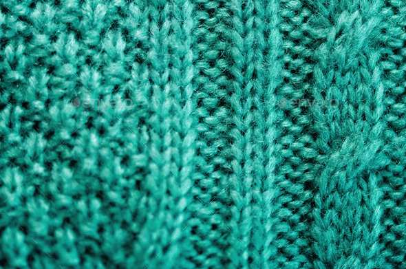 Knitted texture. Pattern fabric made of wool. Turquoise background, copy space - Stock Photo - Images