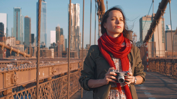 Young photographer on the Brooklyn Bridge in NYC - Stock Photo - Images