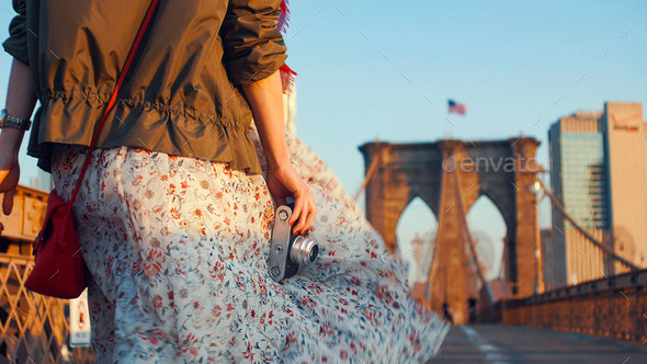 Young woman with a retro camera in NYC - Stock Photo - Images