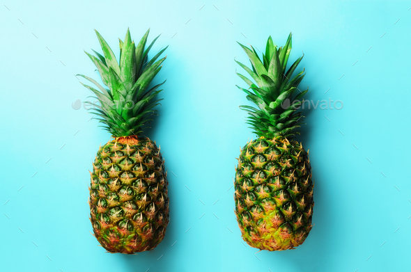 Fresh pineapples on blue background. Top View. Pop art design, creative concept. Copy Space. Bright - Stock Photo - Images