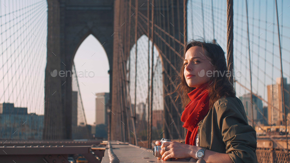 Attractive woman with a retro camera in NYC - Stock Photo - Images