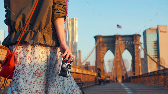 Young photographer with a retro camera on the Brooklyn Bridge - Stock Photo - Images