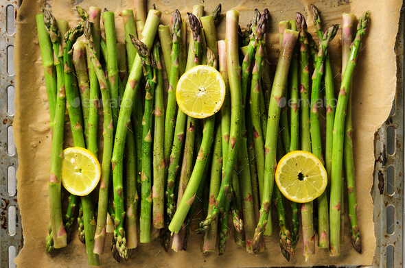 Baked asparagus with lemon. Raw, vegan, vegetarian and clean eating concept - Stock Photo - Images
