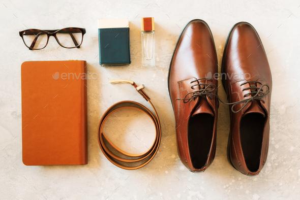 Set of stylish accessories for man on gray background. Flat lay of elegant belt, glasses, parfume - Stock Photo - Images