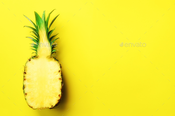 Half of sliced pineapple on yellow background. Top View. Copy Space. Bright pattern for minimal - Stock Photo - Images