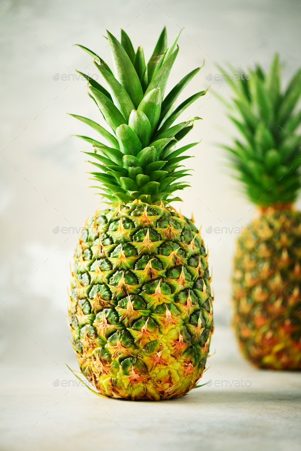 Tropical pineapples on gray background. Summer, holiday concept. Raw, vegan, vegetarian, clean - Stock Photo - Images