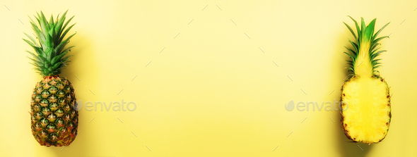Half slice of fresh pineapple and whole fruit on yellow background. Banner. Top View. Copy Space - Stock Photo - Images