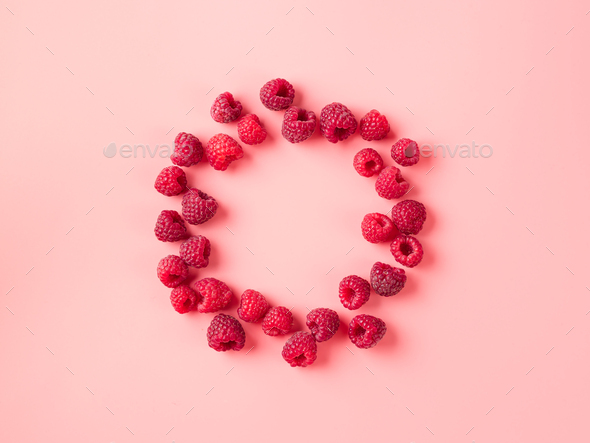 Raspberry in round shape on pink, copy space - Stock Photo - Images