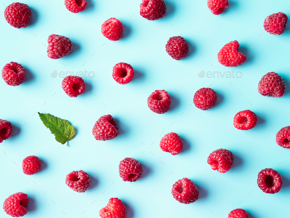 Raspberry pattern, blue background, top view - Stock Photo - Images