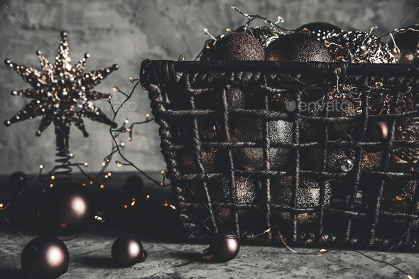 Wicker basket with Christmas toys and holiday decorations lights, copy space, new year decoration - Stock Photo - Images