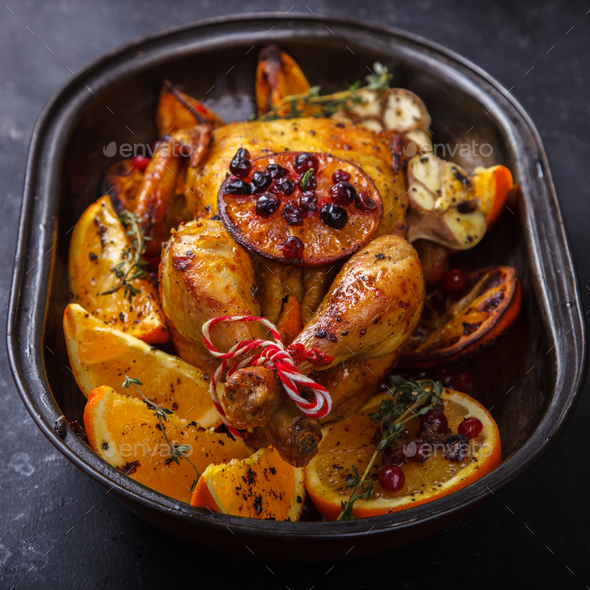 Chicken baked with oranges - Stock Photo - Images