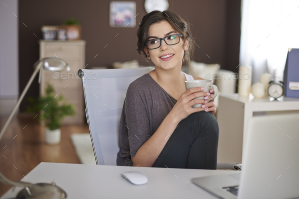 Relaxing with laptop and cup of coffee - Stock Photo - Images