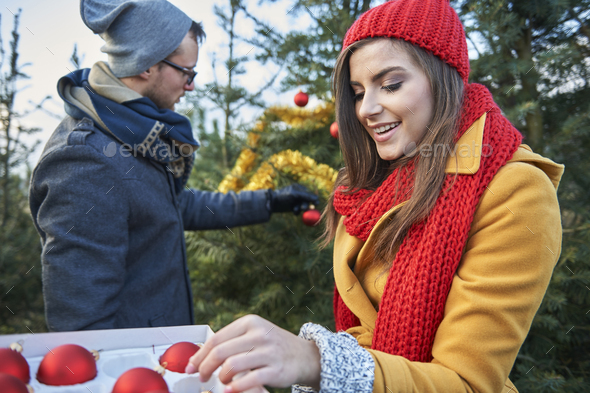 Christmas tree in the garden also must be dressed - Stock Photo - Images
