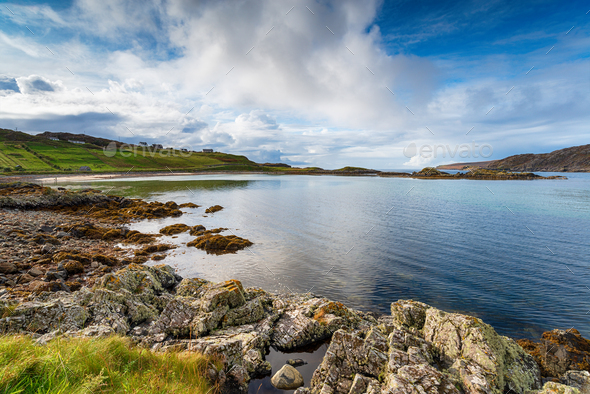 Blue skies over the bay at Scourie in the Highlands of Scotland - Stock Photo - Images