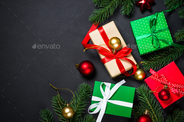 Christmas background with decorations on black - Stock Photo - Images