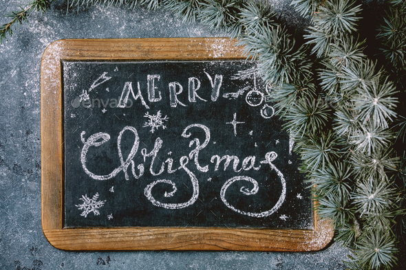 Christmas lettering on chalkboard - Stock Photo - Images