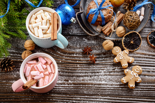Flat lay Christmas background of two mugs of hot chocolate with - Stock Photo - Images