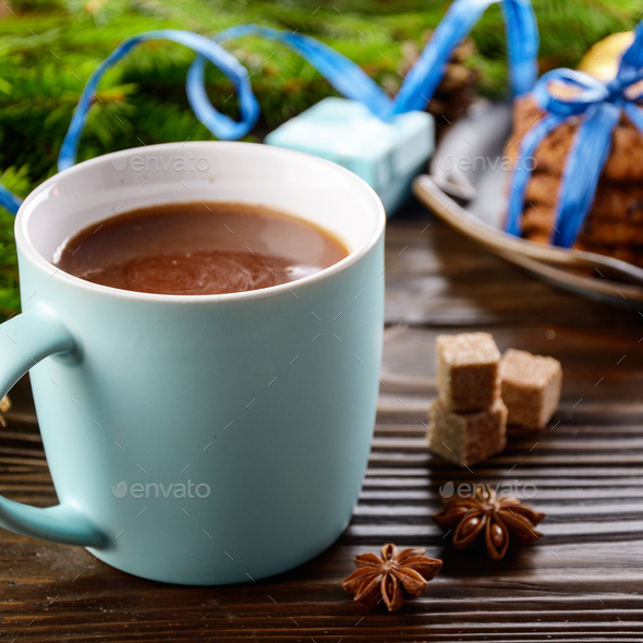 Christmas background of blue hot chocolate mug, spruce branch an - Stock Photo - Images