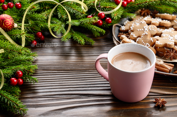 Christmas background of pink mug with hot chocolate, spruce bran - Stock Photo - Images
