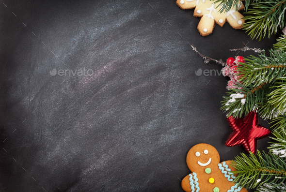 Christmas cookies and fir tree branch - Stock Photo - Images