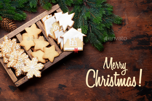 Christmas greeting card with gingerbread cookies - Stock Photo - Images