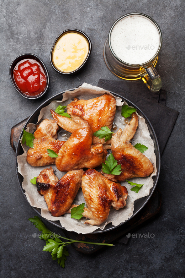 Hot chicken wings and draft beer - Stock Photo - Images