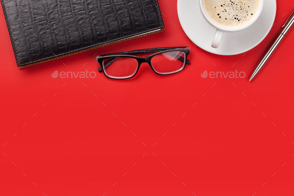Office red workplace with coffee cup and supplies - Stock Photo - Images