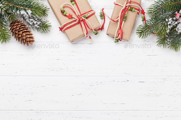 Christmas card with gift boxes and fir tree branch - Stock Photo - Images