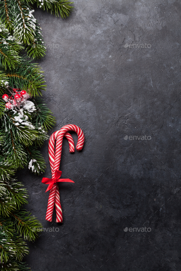 Christmas card with candy canes and fir tree - Stock Photo - Images