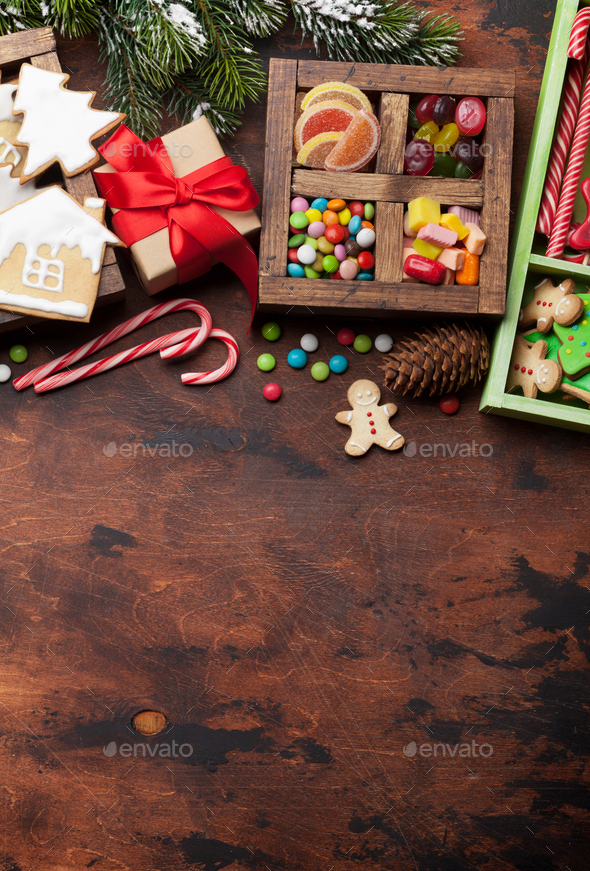 Christmas greeting card with gingerbread cookies and sweets - Stock Photo - Images
