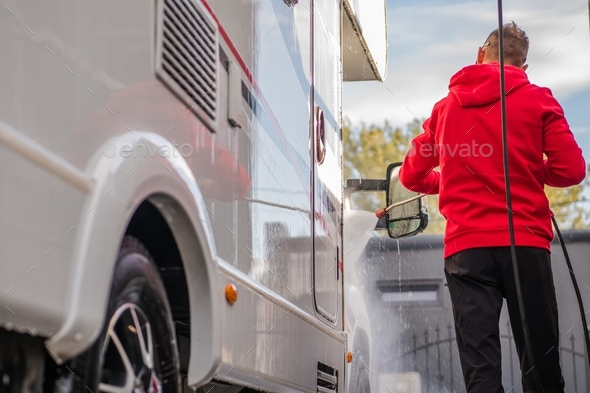 Men Cleaning His Camper - Stock Photo - Images