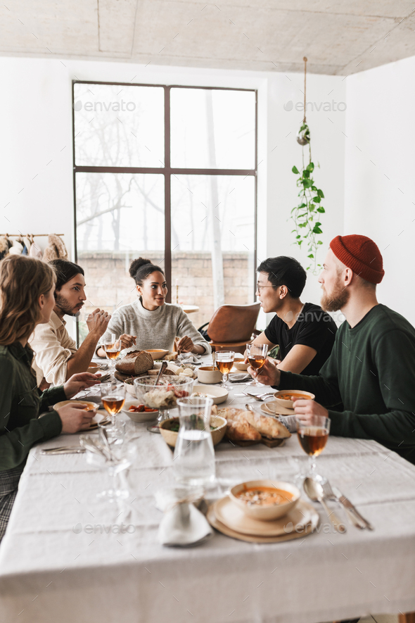 Young colleagues having lunch happily spending time in cozy cafe - Stock Photo - Images