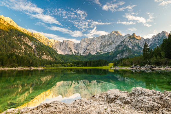 Beautiful Day at Fusine Lake in Italy. Forest and Mountains Refl - Stock Photo - Images