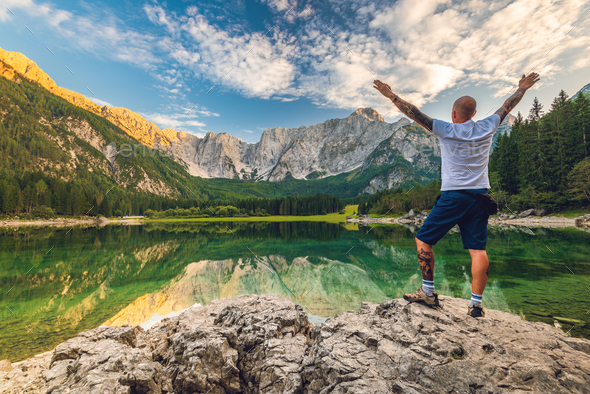Solo Traveller Adventure Man Standing at Beautiful Alpine Lake - Stock Photo - Images