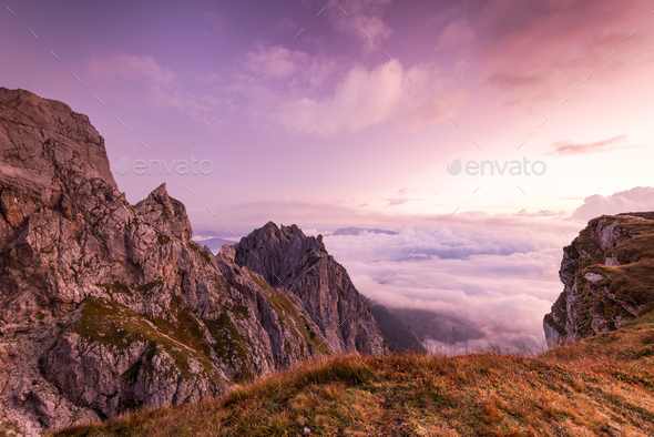 Breathtaking Sunrise at Mountains Peaks above Clouds. Pink Color - Stock Photo - Images