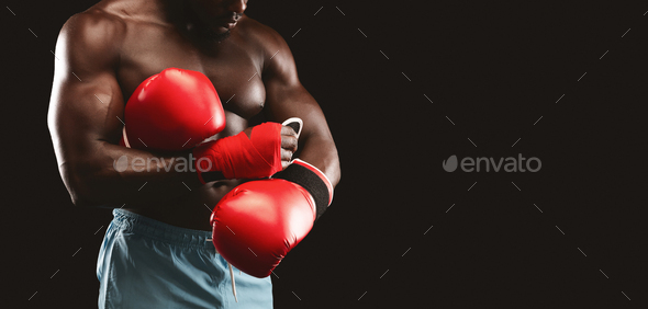 Cropped photo of boxer wearing red gloves - Stock Photo - Images