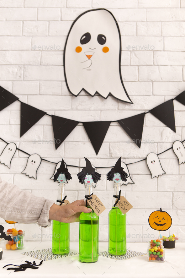 Woman want to drink creative witches cocktail - Stock Photo - Images
