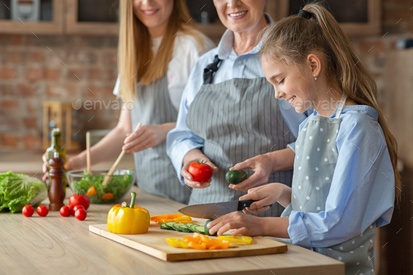 Cropped photo of three women making healthy food - Stock Photo - Images