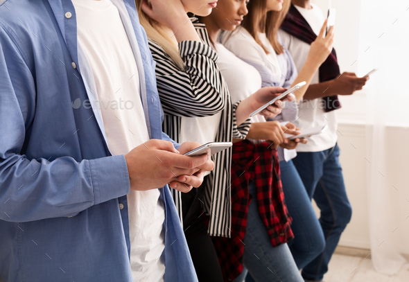Social networks. Friends texting on their smartphones - Stock Photo - Images