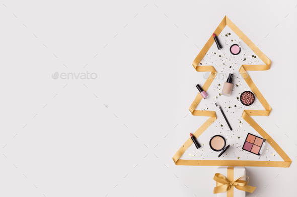 Pine tree with decorative makeup cosmetics garland - Stock Photo - Images