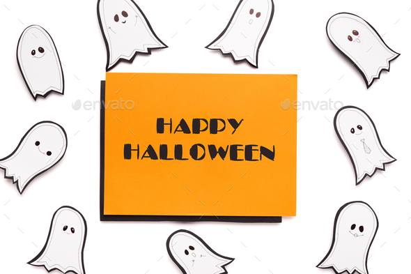 Happy halloween text on orange background with ghosts - Stock Photo - Images