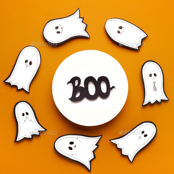 Scary halloween text boo in round frame on orange background - Stock Photo - Images