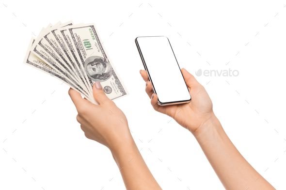 Female holding bunch of dollars and smartphone with blank screen - Stock Photo - Images