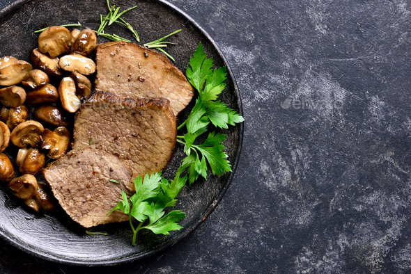 Slow cooked beef with mushrooms - Stock Photo - Images