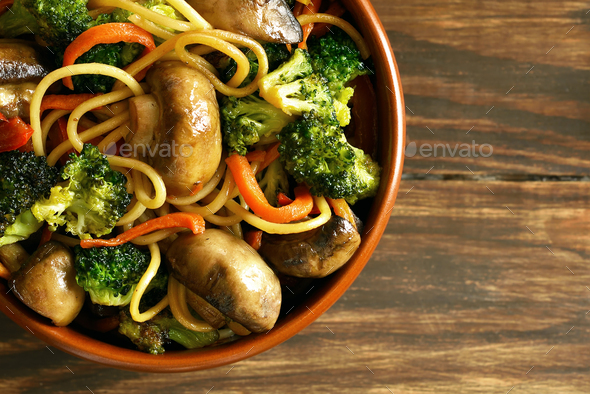 Egg noodles with vegetables in bowl - Stock Photo - Images